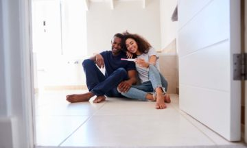 For women fertility couple sitting on floor pregnancy test