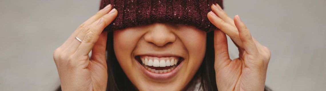 Laughing woman scarf woolly hat