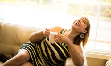 Other consultation services urinary incontinence laughing woman on sofa