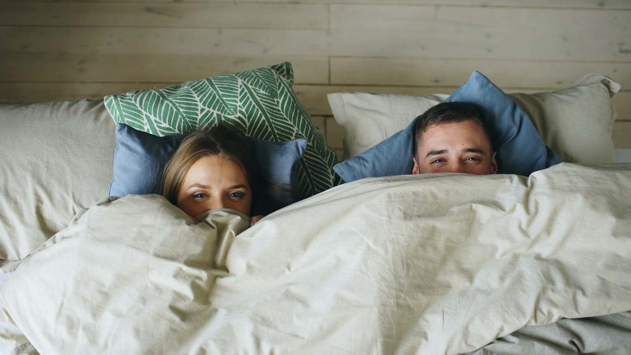 STD - Couple hiding under blanket