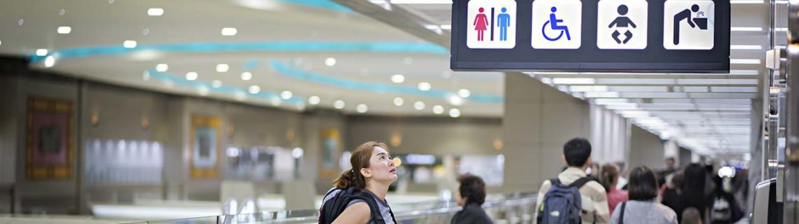 Transgender therapy airport toilet sign